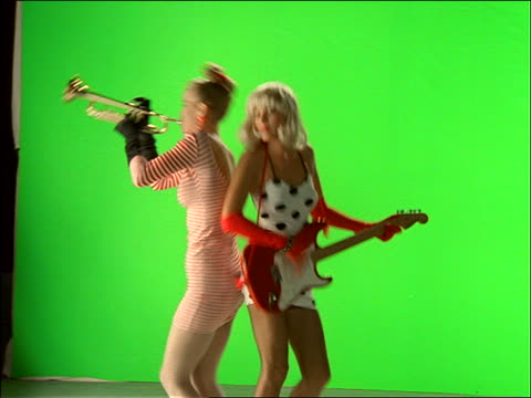 time lapse 2 women play guitar + trumpet with chroma key background