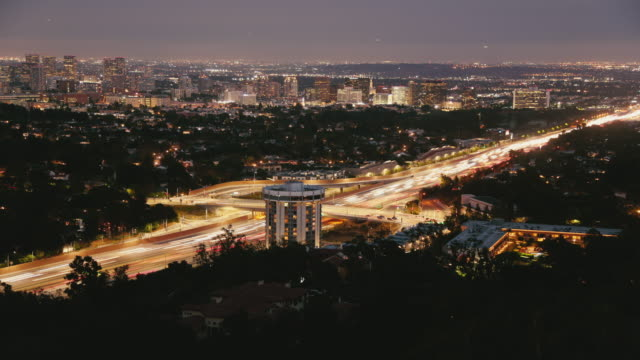 time lapse 405 freeway los angeles at dusk twilight with airplanes with lights landing in distance to lax - westwood neighborhood los angeles stock videos & royalty-free footage