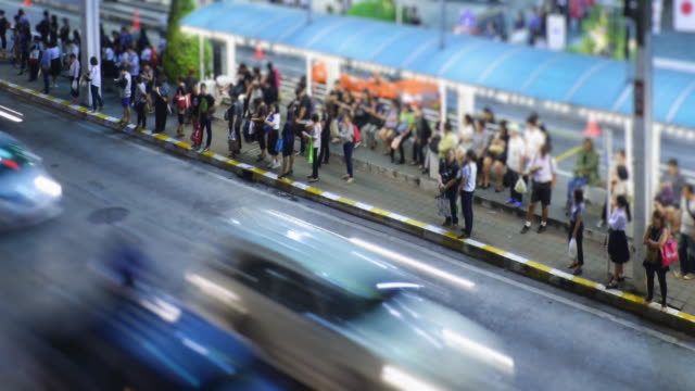 4k time lapse 4096x2160 : people wait and get on the bus - road with cars - night city - long stock videos & royalty-free footage