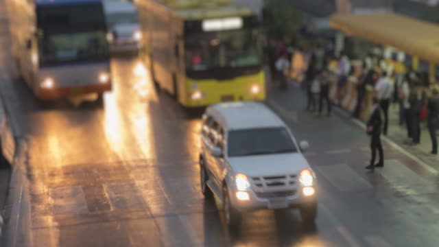 4K time lapse 4096x2160 : People wait and get on the bus - road with cars