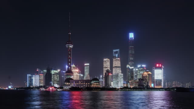 time lapse: 4k shanghai skyline at night. - the bund stock videos & royalty-free footage