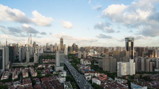 Time Lapse: 4K Time Lapse - Elevated view of Shanghai skyline at dramatic sunset.