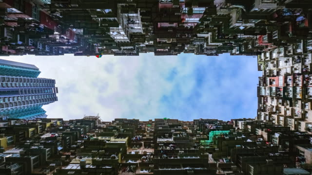 Time lapse 4k video hang kong city apartment building with blue sky.
