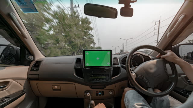time lapse a man driving on the road with green screen dashboard radio touch screen entertainment unit - car interior stock videos & royalty-free footage