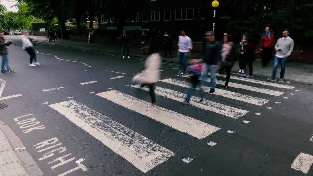 time lapse abbey road famous zebra predestrian crossing - the beatles stock videos & royalty-free footage