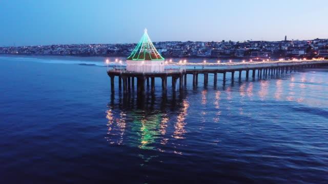 time lapse aerial of pier in manhattan beach - gazebo stock videos & royalty-free footage