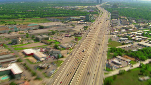 Time lapse aerial point of view over traffic on highway outside Houston / Texas