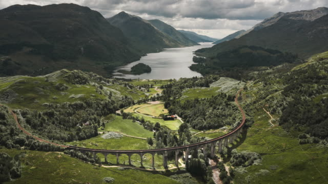 time lapse aerial shot showing glenfinnan viaduct, scotland, united kingdom - scottish culture bildbanksvideor och videomaterial från bakom kulisserna
