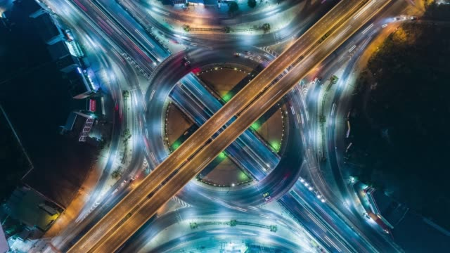 4k time lapse : aerial top view highway road roundabout or intersection, circle at night for transportation, distribution or futuristic background. - roundabout stock videos & royalty-free footage