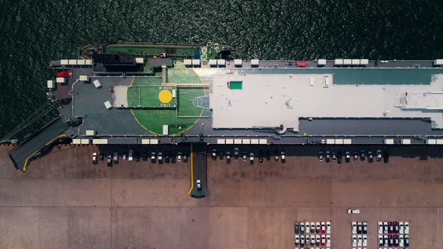 4k time lapse : aerial top view large roro (roll on/off) for carrier vessel convoy cars or vehicle into and out of the world market. business logistics, import export shipping or freight transportation. - selling stock videos & royalty-free footage