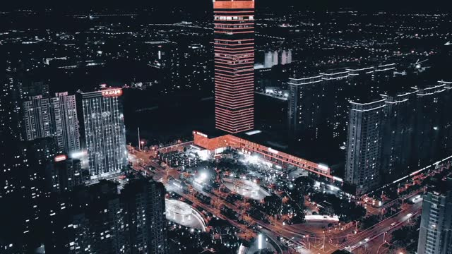 time lapse aerial video footage shows views of zhongyang brics hotel and town at night in hai'an, jiangsu province. footage by: costfoto / barcroft... - illuminated stock videos & royalty-free footage