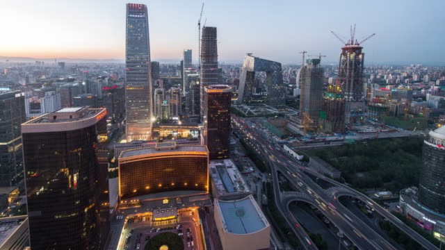 Time Lapse- Aerial view of Beijing CBD area, Day to Night Transition (WS HA Zoom Out)