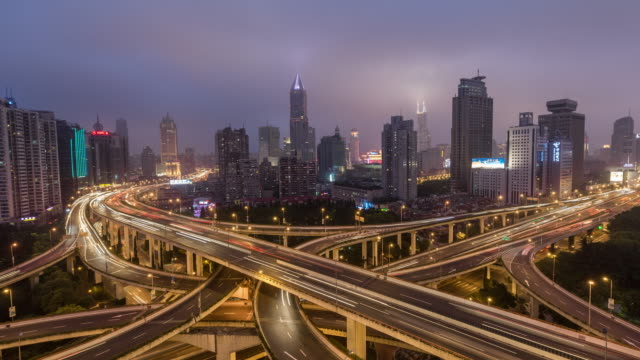 Time Lapse- Aerial View of Busy Overpass at Dawn, from Night to Night (Zoom)