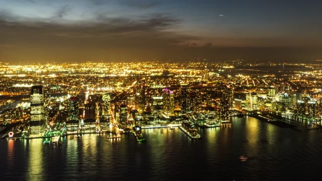 Time Lapse- Aerial View of Jersey City Skyline and the Hudson River at Night / NJ (PAN)