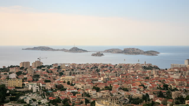 4k time lapse : aerial view of marseille - notre dame de la garde marseille stock videos and b-roll footage