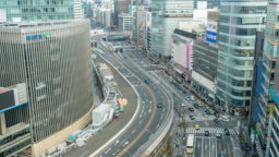 4K Time lapse aerial view of Overpass with crowd car and pedestrian crosswalk intersection Ginza traffic at afternoon time in Tokyo city. Japan, Japanese culture concept