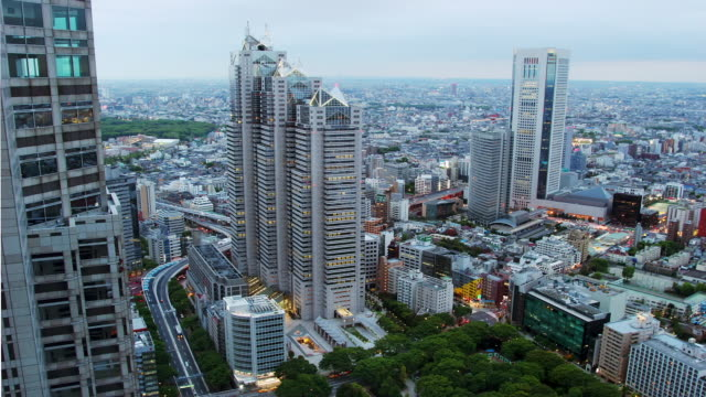time lapse aerial view of shinjuku park tower and opera city tower / day to dusk / tokyo, japan - day to dusk stock videos & royalty-free footage