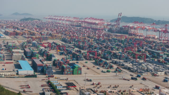 4k time lapse: aerial view of the biggest industrial port with containers ship - biggest stock videos & royalty-free footage