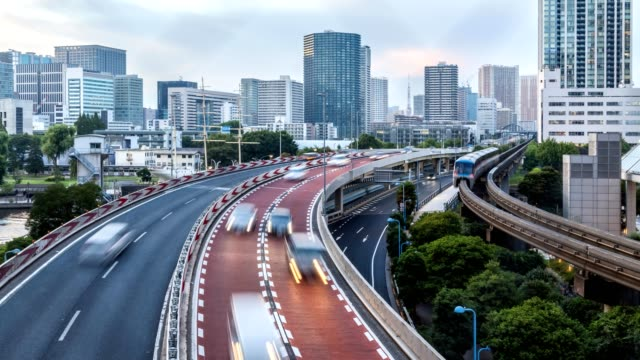 4k time lapse aerial view of tokyo cityscape with highway busy traffic from day time to twilight. - monorail stock videos and b-roll footage
