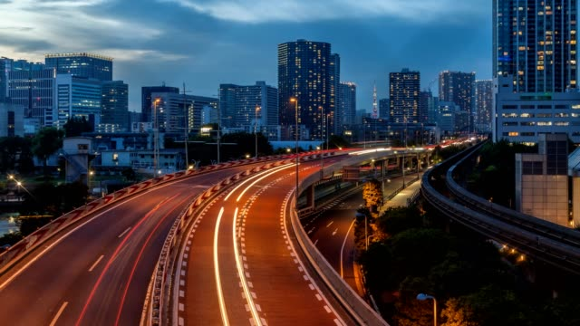 4K time lapse aerial view of Tokyo cityscape with highway busy traffic from day time to night, Tennoz Isel, Tokyo, Japan.