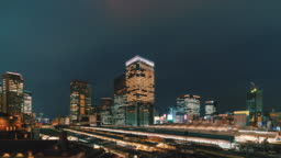 4K Time lapse aerial view of Tokyo Station and Marunouchi with various building cityscape and traffic road at sunset time in Tokyo city, Japan. Japanese culture and transportation concept