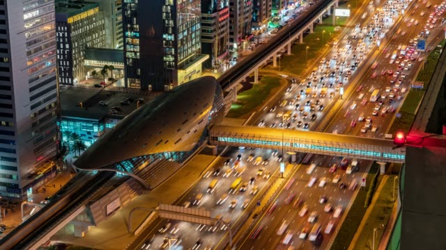 time lapse aerial view of traffic in dubai - electric car stock videos & royalty-free footage