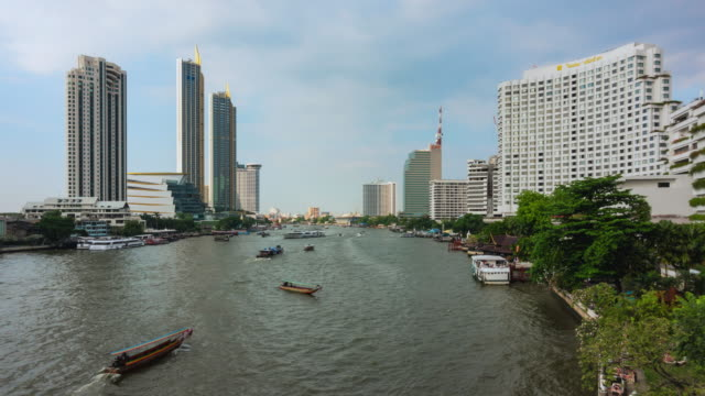 time lapse: aerial view the hustle and traffic boats of chao phraya river pier in bangkok. - passenger craft stock videos & royalty-free footage