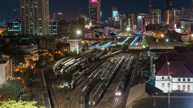 4k time lapse : aerial view traffic of railway junction for train transportation at night time. - railway junction stock videos & royalty-free footage