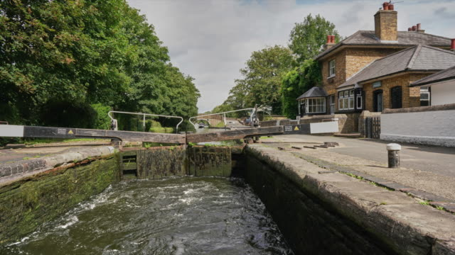 a time lapse along the grand union canal  in west london up to cowley lock - barge stock videos & royalty-free footage