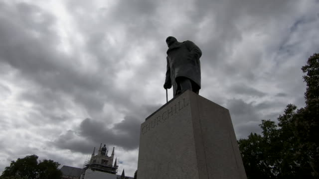 time lapse and low angle view of the winston churchill statue in parliament square - angle stock videos & royalty-free footage