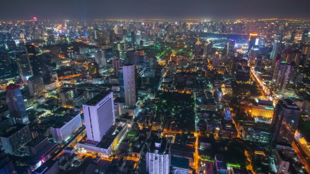 time lapse and wide shot: bangkok cityscapes in night time. - wide stock videos & royalty-free footage