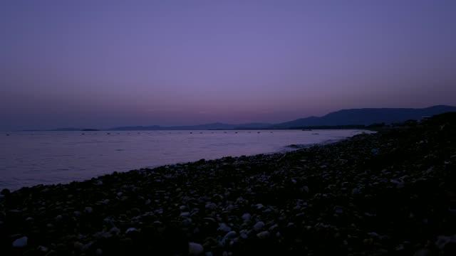 stockvideo's en b-roll-footage met time lapse op het strand - gevuld