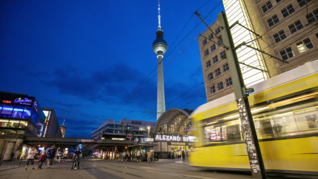 time lapse at berlin alexanderplatz with tv tower in the background - alexanderplatz stock videos & royalty-free footage