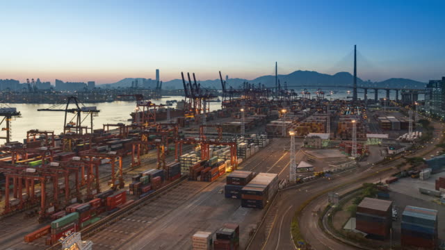 4k time lapse at dawn : container cargo warehouse activity at terminal commercial port for business logistics, import export, shipping or transportation. - freight elevator stock videos & royalty-free footage