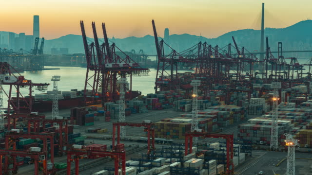 4k time lapse at dawn : container cargo warehouse activity at terminal commercial port and working crane bridge load or unload container for business logistics, import export, shipping or transportation. - freight elevator stock videos & royalty-free footage