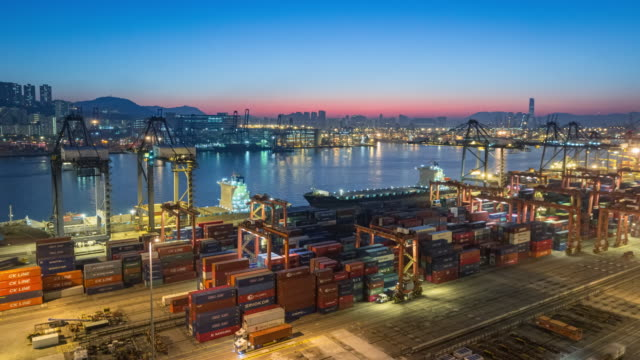 4k time lapse at dawn : container cargo warehouse at terminal commercial port and working crane bridge load or unload container for business logistics, import export, shipping or transportation. - freight elevator stock videos & royalty-free footage