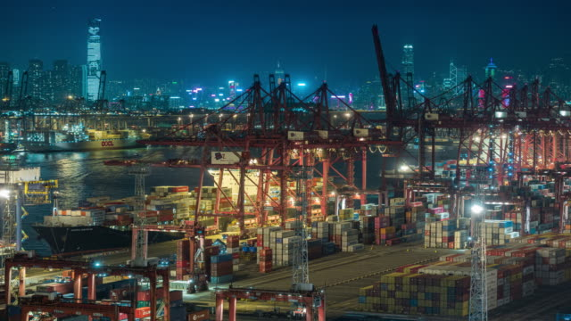 4k time lapse at dusk : container cargo warehouse at terminal commercial port and working crane bridge load or unload container with cityscape background for business logistics, import export, shipping or transportation - freight elevator stock videos & royalty-free footage