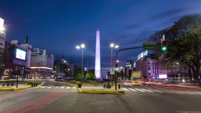 time lapse at dusk in avenue of 9 de julio with obelisk in the background, buenos aires, argentina - plaza de la república buenos aires stock videos & royalty-free footage