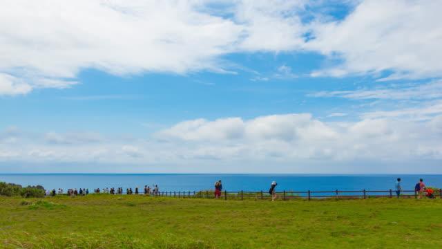 time lapse at manzamo cape view point, okinawa japan - scogliera video stock e b–roll