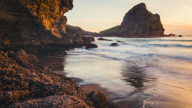 time lapse at piha beach, auckland, new zealand. - tide stock videos & royalty-free footage