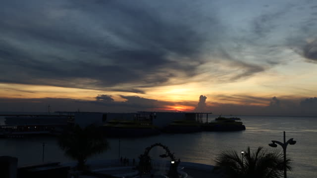 time lapse at sunset overlooking the cozumel ferry terminal and ocean from above - ferry terminal stock videos & royalty-free footage