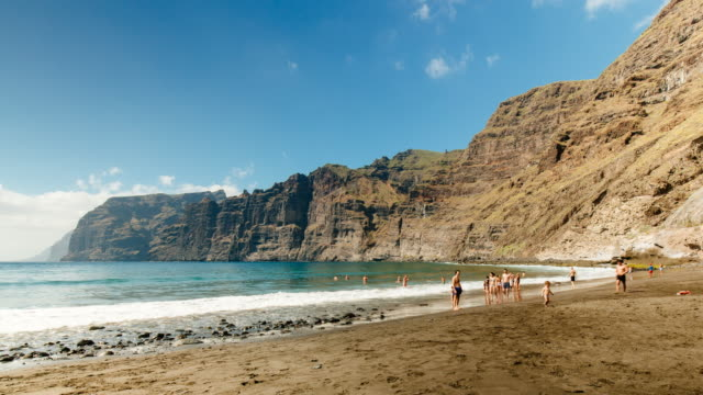 4K Time lapse at The Cliffs of Los Gigantes, 'The Giants', with the beach, Tenerife, Spain
