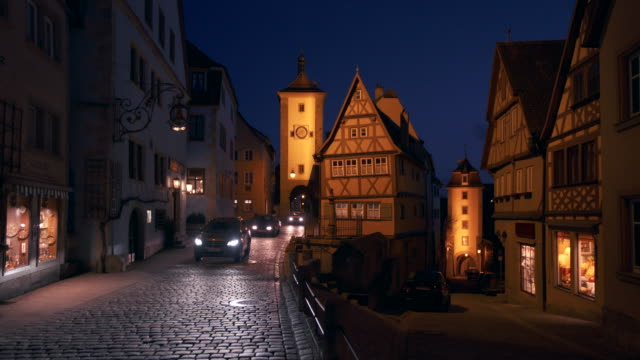 time lapse at the ploenlein with sieber tower and kobolzeller tower illuminated at dusk twilight. - rothenburg stock videos and b-roll footage