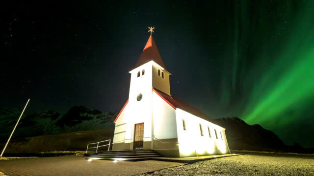 hd time lapse : aurora over at vik church - full hd format stock videos & royalty-free footage