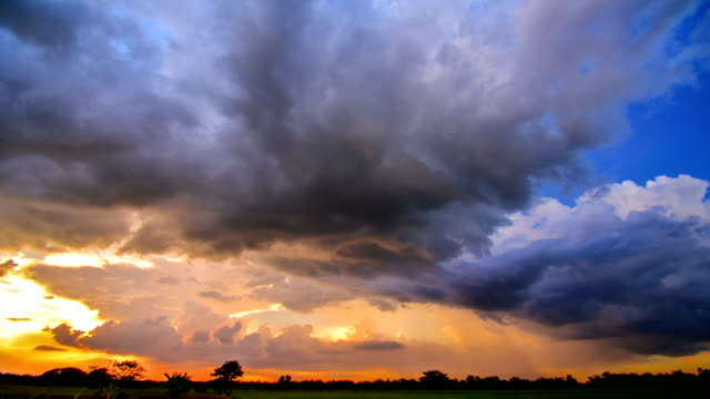 4k time lapse: background moving cloud rain at sunset - storm cloud stock videos & royalty-free footage