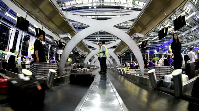 Time lapse baggage conveyor belt at airport