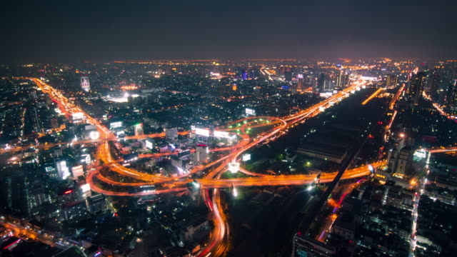 time lapse bangkok traffic city at night - zoom out stock videos & royalty-free footage
