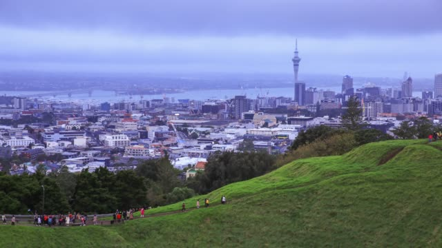 4k time lapse : beautiful auckland cityscape in evening. - north island new zealand stock videos & royalty-free footage