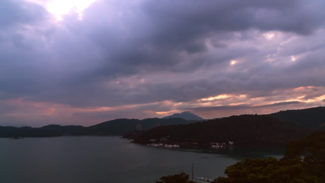 4k time lapse: beautiful cloudscape of sun moon lake at the sunset, taiwan - sun moon lake stock videos and b-roll footage