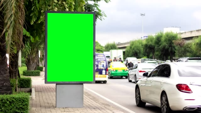 time lapse, billboard green screen city side street signs. - billboard stock videos & royalty-free footage